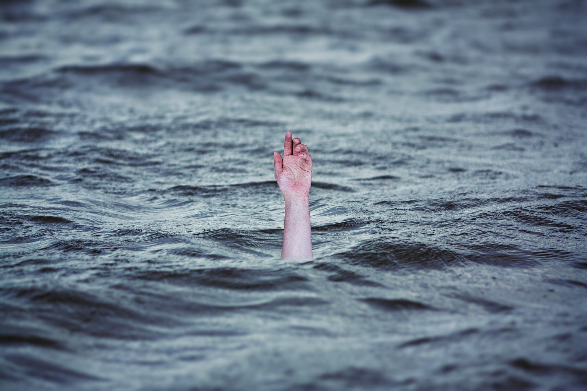 single hand drowning in the ocean
